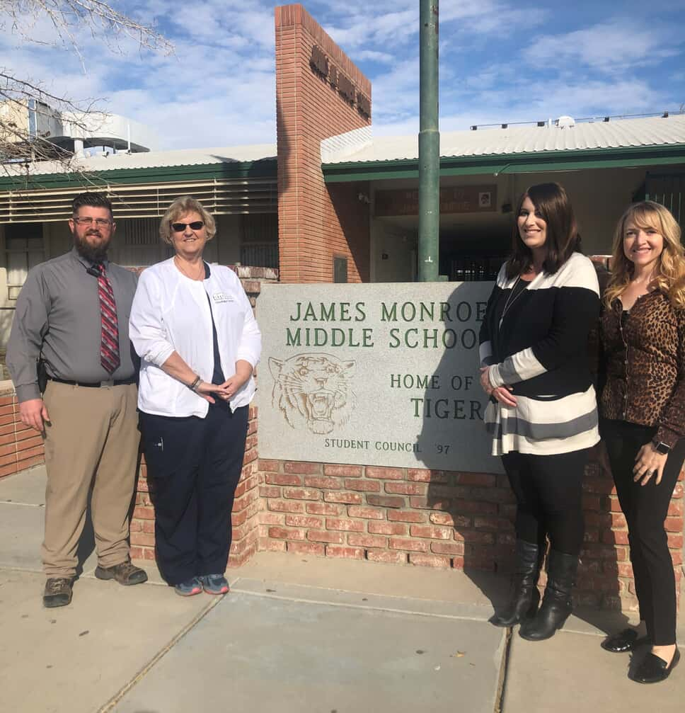 Monroe Middle school sign with nurses